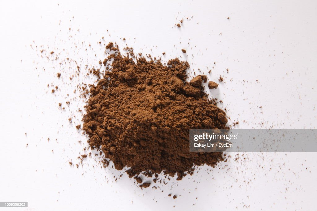 High Angle View Of Ground Coffee Over White Background : Stock Photo