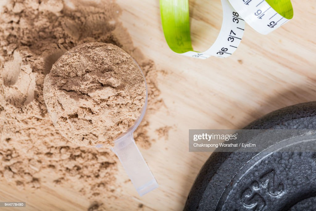 High Angle View Of Grounded Food In Container On Table : Stock Photo