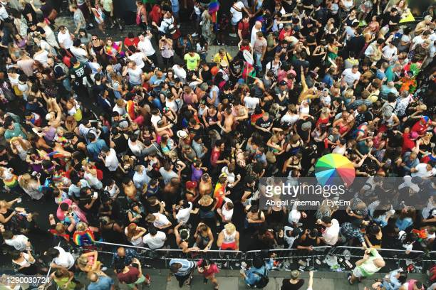 high angle view of group crowd of people at pride london - celebration stock pictures, royalty-free photos & images
