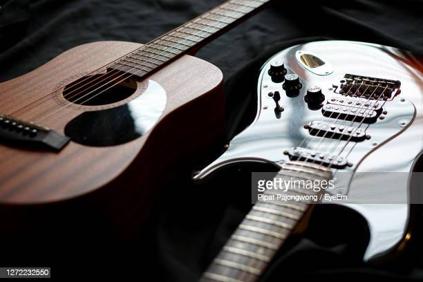 high angle view of guitar - acoustic guitar stock pictures, royalty-free photos & images