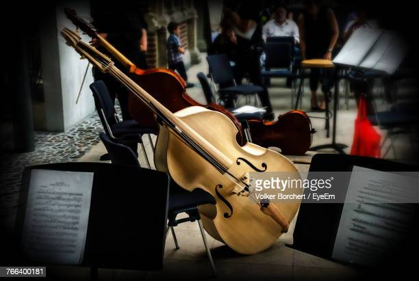high angle view of guitars on floor against chair - concert hall stock pictures, royalty-free photos & images