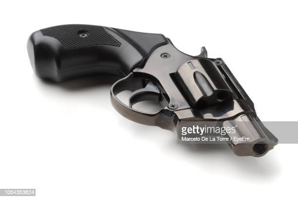 high angle view of gun against white background - handgun stock pictures, royalty-free photos & images