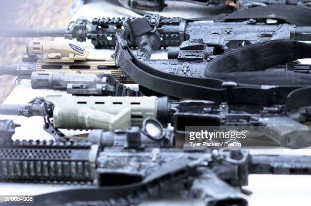 high angle view of guns on table - weaponry stock pictures, royalty-free photos & images