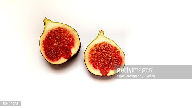 High Angle View Of Halved Fig Fruit On White Background
