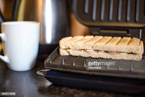High Angle View Of Ham And Cheese Toasted Sandwich on breakfast