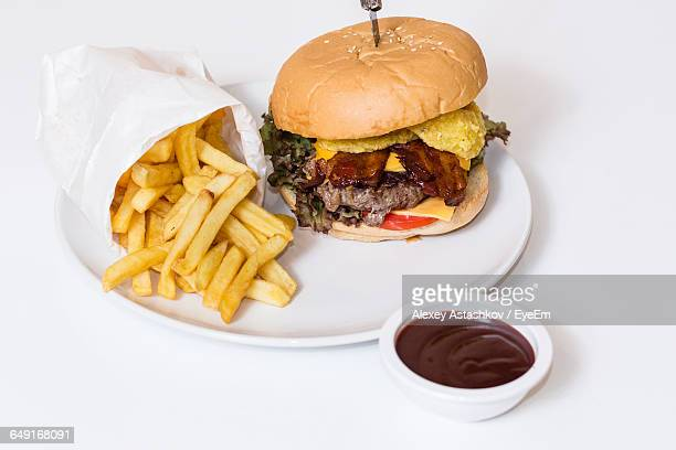 High Angle View Of Hamburger And French Fries On Table