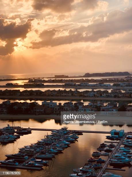 high angle view of harbor at sunset - moored stock pictures, royalty-free photos & images