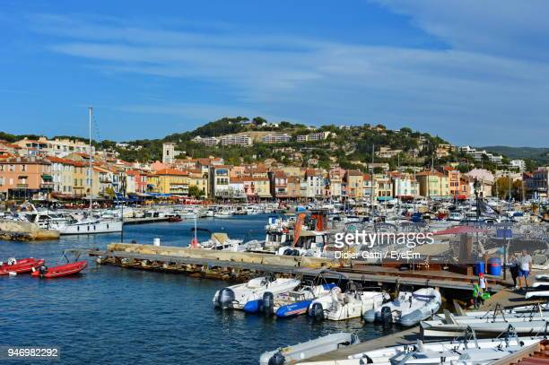 high angle view of harbor by sea against sky - cassis stock pictures, royalty-free photos & images