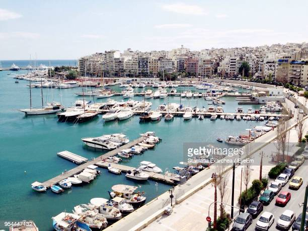 high angle view of harbor by sea against sky - piraeus stock photos and pictures