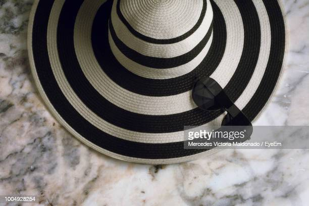 High Angle View Of Hat And Sunglasses On Marble Floor