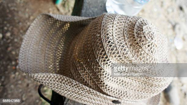 High Angle View Of Hat On Railing