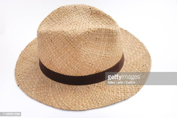 high angle view of hat on white background - sun hat stock pictures, royalty-free photos & images