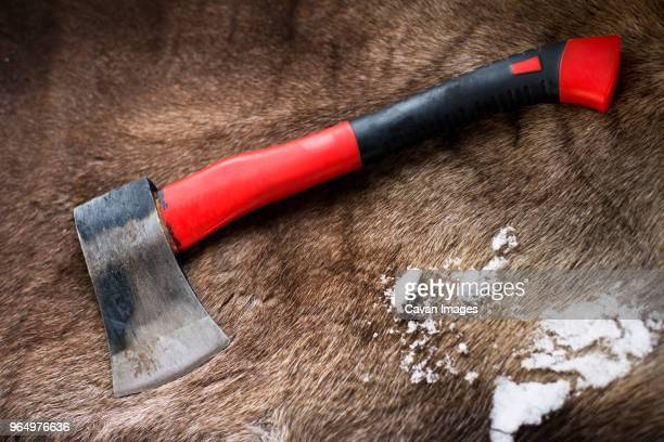 high angle view of hatchet and snow on reindeer skin rug - bearskin rug imagens e fotografias de stock