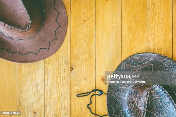 High Angle View Of Hats On Table