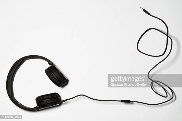 high angle view of headphones on white background - ケーブル線 ストックフォトと画像