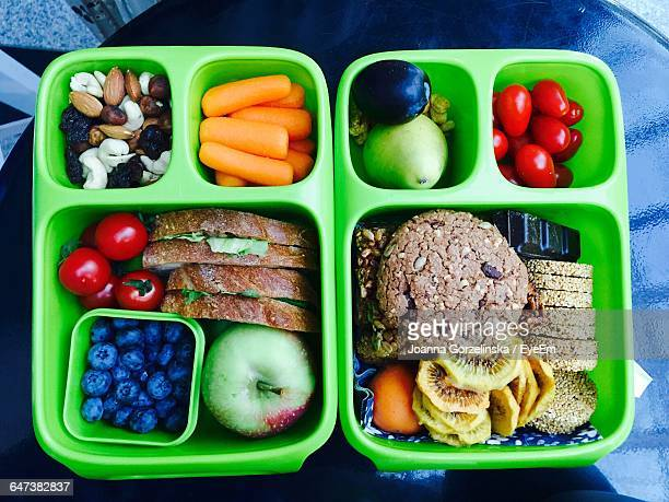 High Angle View Of Healthy Food In Green Lunch Box