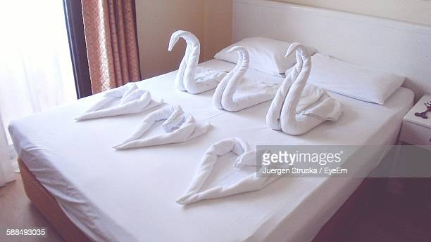 High Angle View Of Heart And Swan Shapes Art On Bed In Bedroom