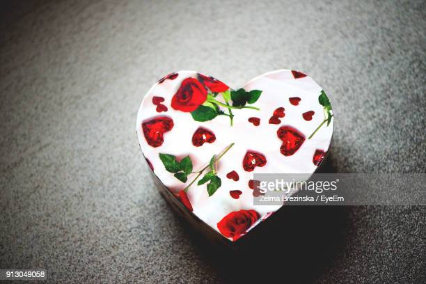high angle view of heart shape container on table - brezinska stock pictures, royalty-free photos & images
