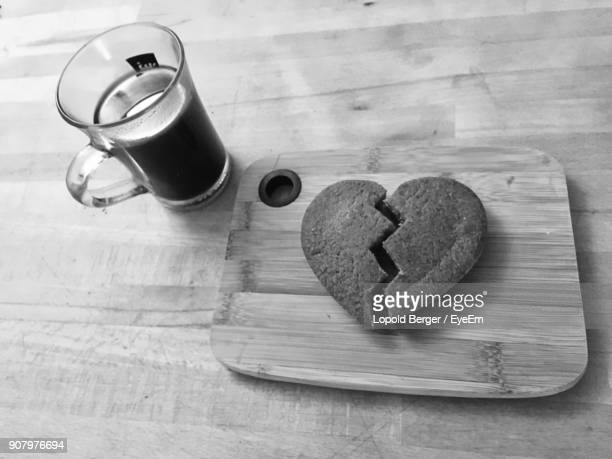 High Angle View Of Heart Shape Cookie By Coffee On Table