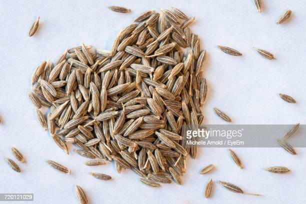 High Angle View Of Heart Shape Cumin Seeds On Table