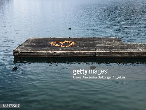 High angle view of heart shape drawing on pier in lake stock photo high angle view of heart shape drawing on pier in lake stock photo getty images freerunsca Gallery