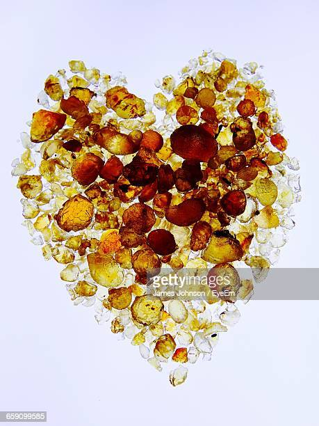 High Angle View Of Heart Shape Frankincense Against White Background