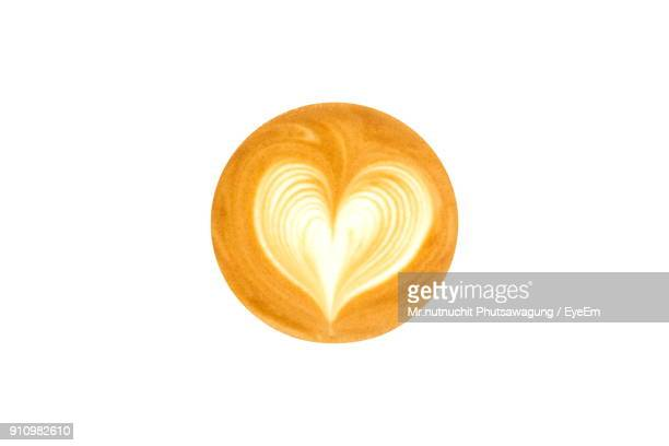 High Angle View Of Heart Shape On Coffee Over White Background