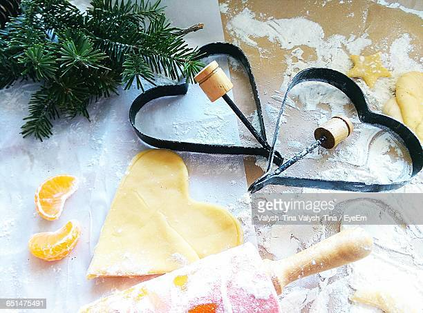 High Angle View Of Heart Shape Pastry Cutter And Dough