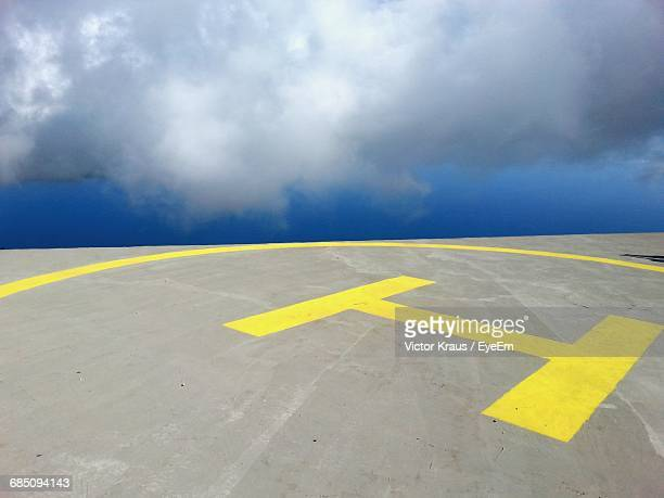 High Angle View Of Helipad Against Cloudy Sky