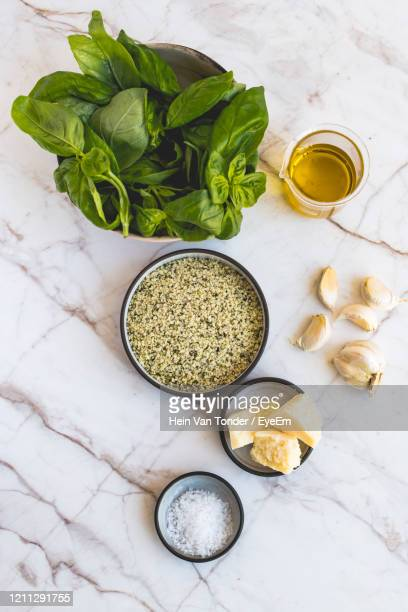 high angle view of hemp pesto ingredients on table - pesto stock pictures, royalty-free photos & images