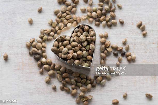 high angle view of hemp seeds on table - hemp seed stock photos and pictures