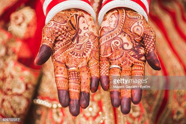 High Angle View Of Henna Tattoo On Bride Hands