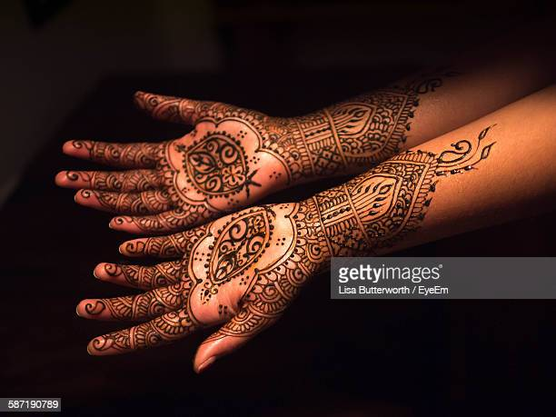 High Angle View Of Henna Tattoo On Woman Hands