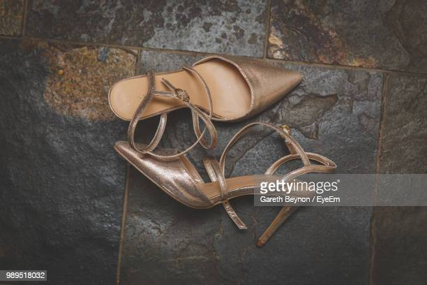 high angle view of high heels on footpath - tacchi alti foto e immagini stock