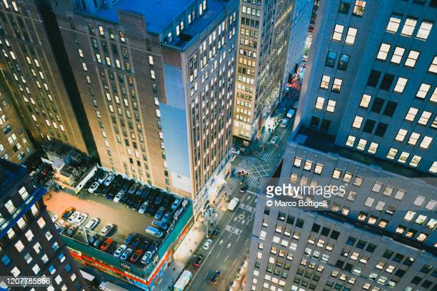high angle view of high rise buildings over 7th ave at night, new york city - manhattan new york city stock pictures, royalty-free photos & images