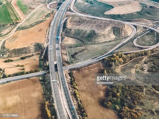 high angle view of highway in city - bortes stock-fotos und bilder