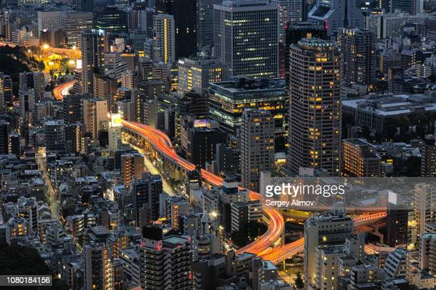 high angle view of highways and tall buildings in tokyo downtown - roppongi hills stock pictures, royalty-free photos & images
