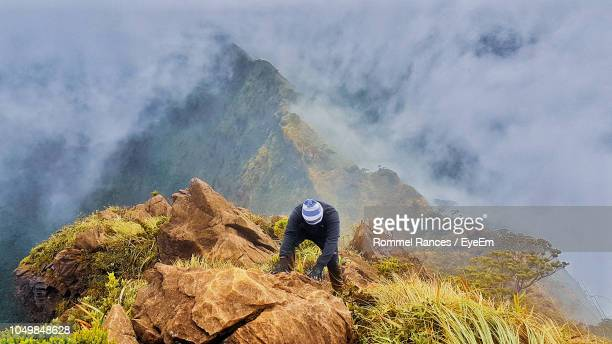high angle view of hiker hiking on mountain - free climbing stock pictures, royalty-free photos & images