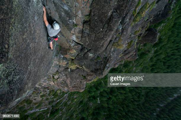 high angle view of hiker rock climbing - rock wall stock pictures, royalty-free photos & images