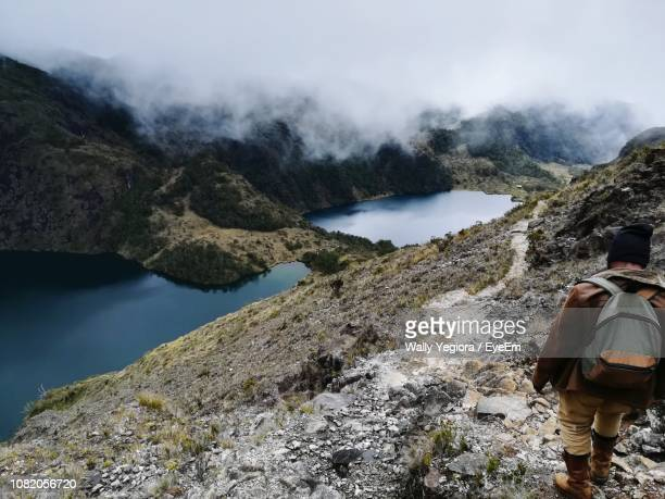 high angle view of hiker standing on mountain - oceania stock pictures, royalty-free photos & images