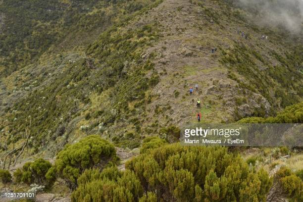 high angle view of hikers against mountain - kenya stock pictures, royalty-free photos & images