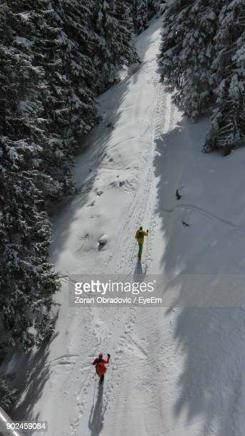High Angle View Of Hikers On Snowfield