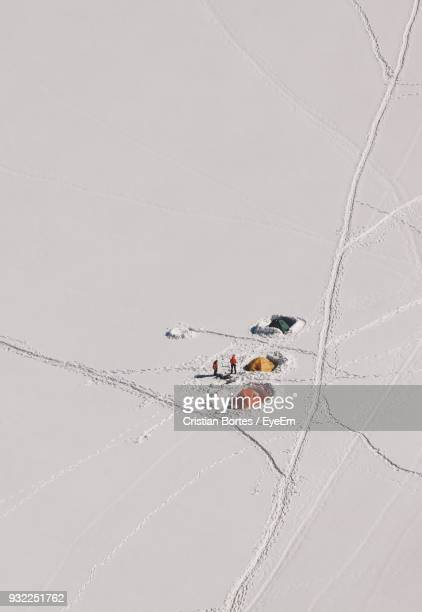 High Angle View Of Hikers On Snowy Field