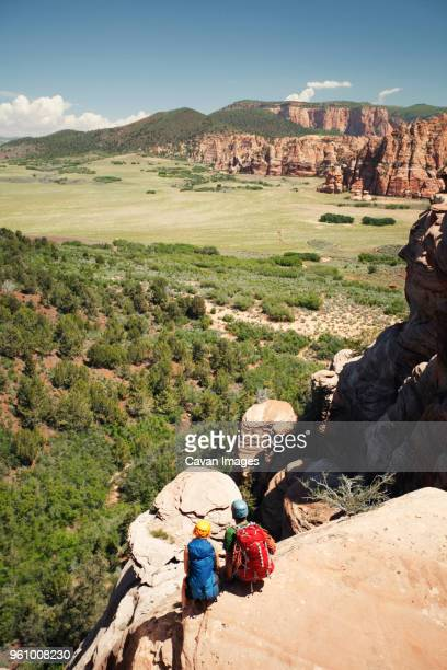 High angle view of hiking couple looking at view