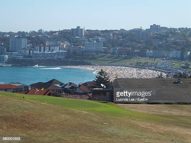high angle view of hill by river and city against clear sky - lucinda lee stock photos and pictures