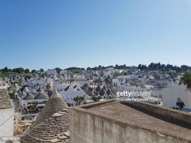 high angle view of historic building against sky - alberobello stock pictures, royalty-free photos & images