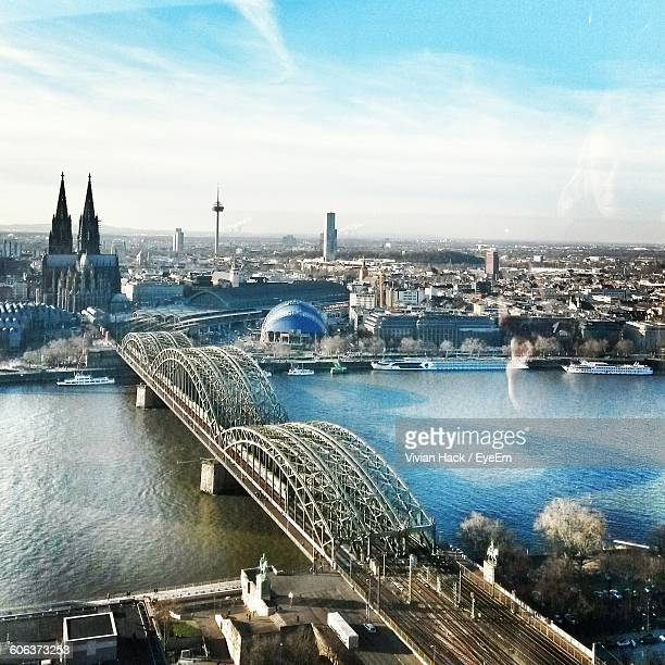 High Angle View Of Hohenzollern Bridge Over Rhine River In City Seen Through Window