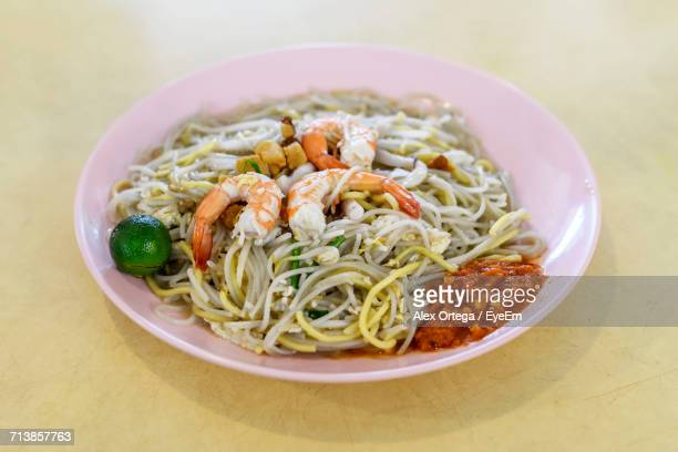 High Angle View Of Hokkien Mee In Pink Plate On Beige Table
