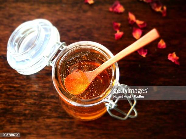 High Angle View Of Honey In Jar On Table