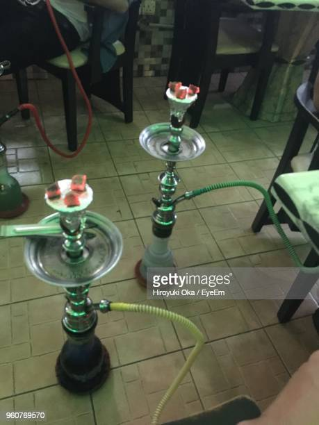 High Angle View Of Hookah On Tiled Floor